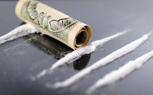 Lines of cocaine and hundred dollar bill